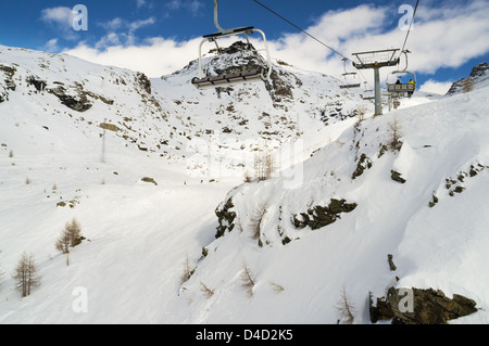 alps mountain with rocks covered with snow in winter, monterosa ski italy - Stock Photo