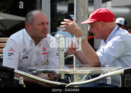 Briton Ron Dennis (L), team principal of McLaren Mercedes, chats with former Austrian world champion Niki Lauda - Stock Photo