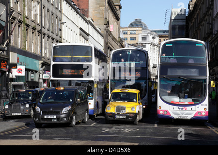 Buses and taxis on Union Street in Glasgow city centre, Scotland, UK - Stock Photo