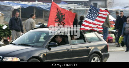 Kosovo-Albanians wave their flags celebrating the acquittal for former Kosovo prime minister and rebel commander - Stock Photo