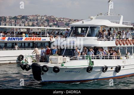 Group of passengers, tourists and citizens alike on passenger ferries in Istanbul, Turkey. - Stock Photo