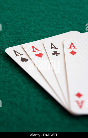 Close-up of four playing cards showing aces. - Stock Photo