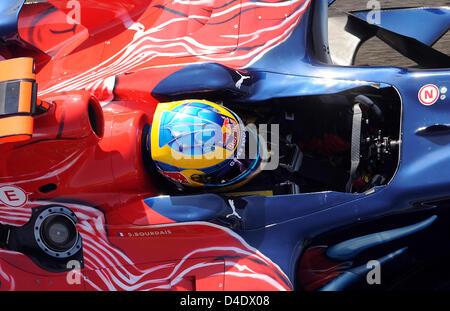 French Formula One driver Sebastien Bourdais of Scuderia Toro Rosso-Ferrari steers his car trough the pit lane during - Stock Photo