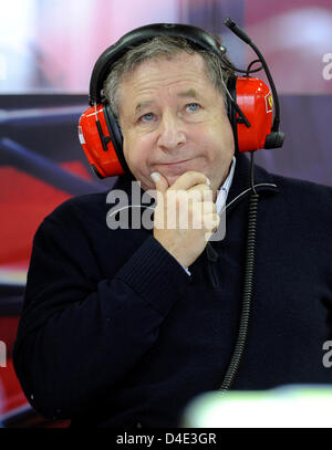 Former CEO of Scuderia Ferrari, French Jean Todt, looks onto the screen during the third Practice Session at Fuji - Stock Photo