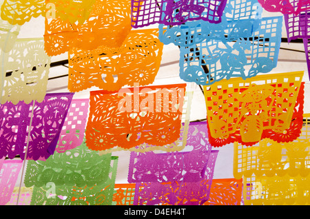 Brightly colored cut paper flags with Day of the Dead designs in Oaxaca, Mexico. - Stock Photo