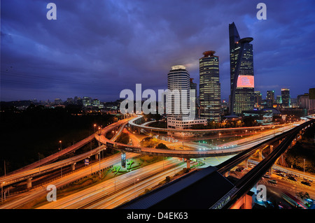 Kuala Lumpur Skyscrapers and Highways - Stock Photo
