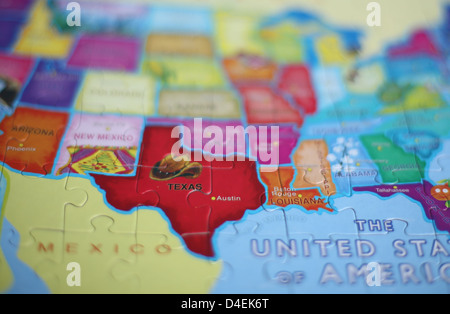 A Close Up Of The State Of Texas On A Puzzle Map Stock Photo