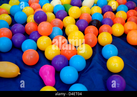 Many coloured plastic balls from children's small town - Stock Photo