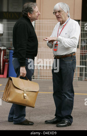 French former Scuderia Ferrari CEO Jean Todt (L) chats with F1 supremo Bernie Ecclestone (R) in Monte Carlo, Monaco, - Stock Photo