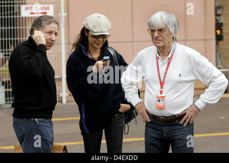 French former Scuderia Ferrari CEO Jean Todt (L), his fiancee Malaysian actress Michelle Yeoh (C) and F1 supremo - Stock Photo