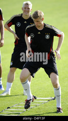 Germany's Per Mertesacker (R) and Bastian Schweinsteiger are pictured during a first training session of the German - Stock Photo