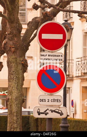 A no entry and no parking sign in France. - Stock Photo
