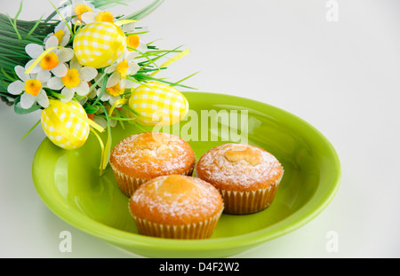 Easter cakes with flowers on white background - Stock Photo