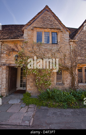 An ivy covered house in Castle Combe, Wiltshire, England, UK. - Stock Photo
