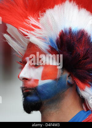 A Croatian supporter has his face painted in national colours prior to the UEFA EURO 2008 Group B preliminary round - Stock Photo