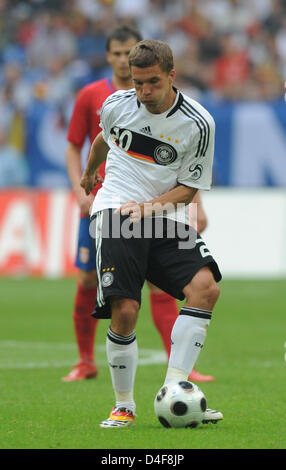 German forward Lukas Podolski is seen in action during the international match vs Serbia at Veltins Arena in Gelsenkirchen, - Stock Photo