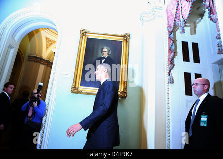 Illuminated by other photographers' flashes, United States President Barack Obama leaves after meeting with members - Stock Photo