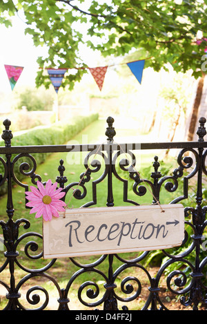 'Reception' sign on wrought iron fence - Stock Photo