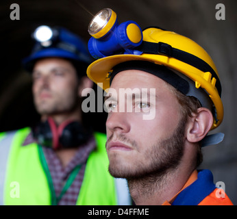 Close up of worker's face in tunnel - Stock Photo