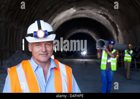 Businessman standing in tunnel - Stock Photo