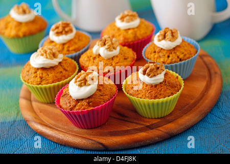 Cupcakes with carrots and walnuts. Recipe available. - Stock Photo