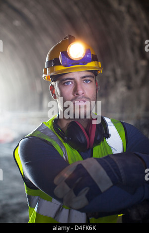 Worker standing in tunnel - Stock Photo