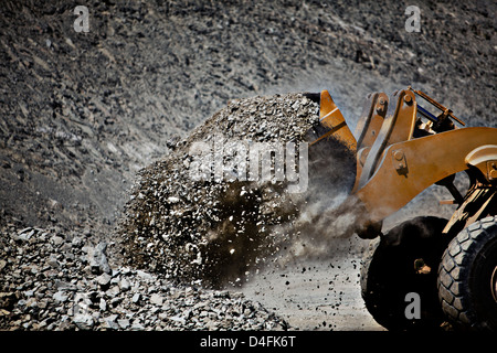 Digger working in quarry - Stock Photo