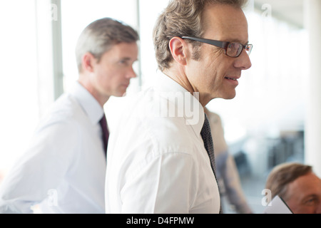 Businessmen talking in meeting - Stock Photo