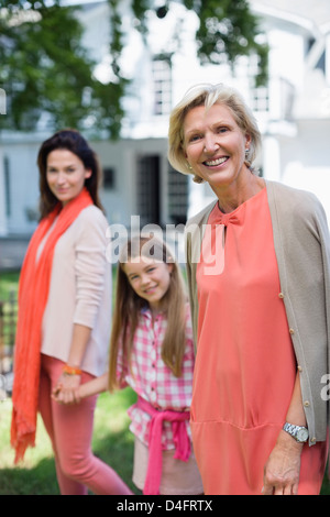 Three generations of women walking together - Stock Photo