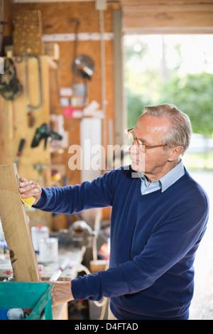 Man working in garage - Stock Photo