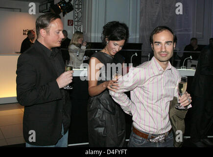 Producer Minu Barati (C), wife of former German Foreign Minister Joschka Fischer, and fashion designers Claus Unrath - Stock Photo