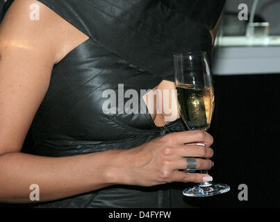 Producer Minu Barati, wife of former German Foreign Minister Joschka Fischer, holds a glass of champagne in front - Stock Photo