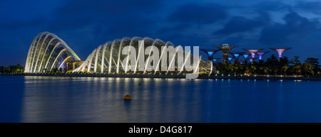 Flower Dome and Cloud Forest with Super Trees in Marina Bay Gardens, Singapore - Stock Photo