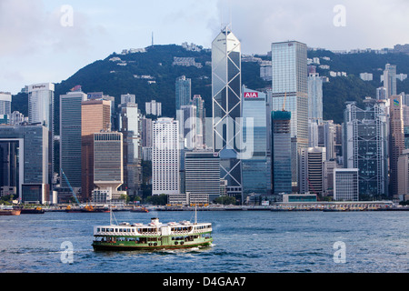 Star Ferry on Victoria Harbour with Hong Kong skyline (Central) in the background. - Stock Photo