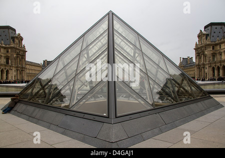 child looking through the glass at the louvre in paris - Stock Photo
