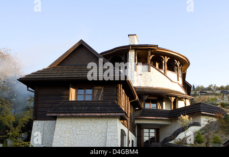 Suburban home in afternoon sunlight. Mountanneous house. - Stock Photo