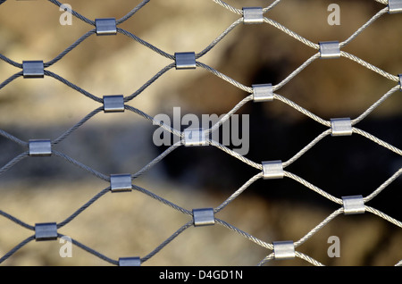 Wire fence with water on background  - Stock Photo