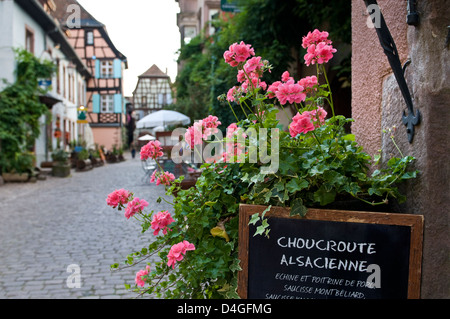 Choucroute Alsacienne in Riquewihr France menu with flowers for typical Alsace delicacy Riquewihr France - Stock Photo