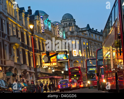 Theatreland with red buses in Shaftesbury Avenue West End London UK - Stock Photo