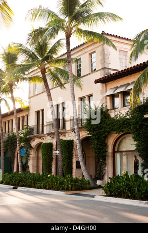Sunrise with palm trees and storefronts on Worth Avenue, West Pam Beach Florida - Stock Photo