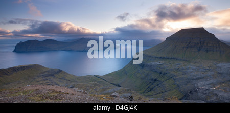 Looking towards the Island of Vagar from the mountains of Streymoy, Faroe Islands, Europe. Summer (June) 2012. - Stock Photo