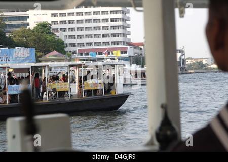 Ferry boat crossing Chao Phraya river in Bangkok , Thailand - Stock Photo