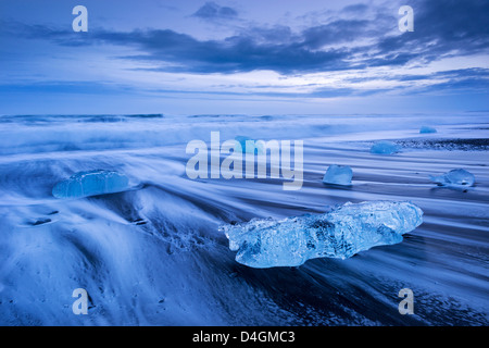 Ice and waves on Jokulsarlon Beach, South Iceland. Winter (January) 2013. - Stock Photo