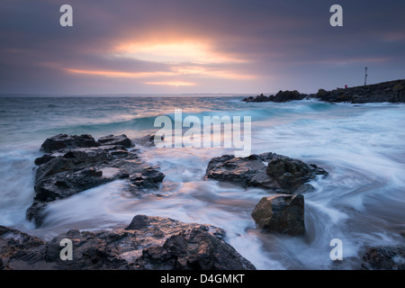 Sunrise at Porthgwidden Beach in St Ives, Cornwall, England. Winter (March) 2013. - Stock Photo