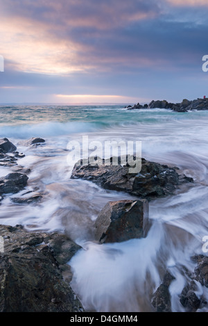 Sunrise at Porthgwidden Beach in St Ives, Cornwall, England. Winter (March) 2013 - Stock Photo
