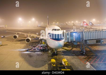 Boeing 747-400 Jumbo jet airliner of Cathay Pacific Airways at Hong Kong International Airport at night, Hong Kong, - Stock Photo
