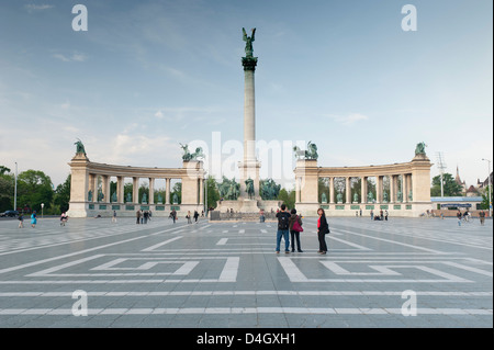 People looking at statues of Hungarian historical leaders, Millennium Monument, Hosok Tere (Heroes Square), Budapest, - Stock Photo
