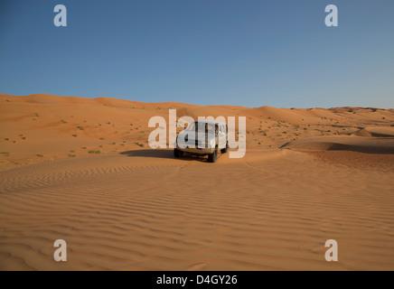 Four wheel drive on desert dunes, Wahiba, Oman, Middle East - Stock Photo