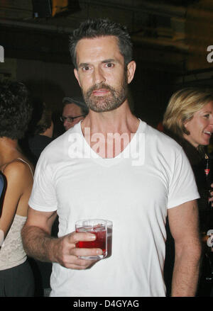 British actor Rupert Everett is pictured at a party after the fashion show of designer Michael Michalsky at the - Stock Photo