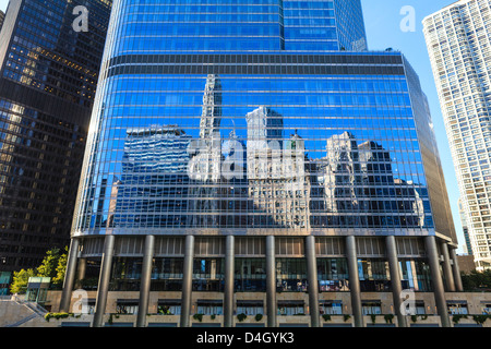 Skyscrapers on West Wacker Drive reflected in the Trump Tower, Chicago, Illinois, USA - Stock Photo